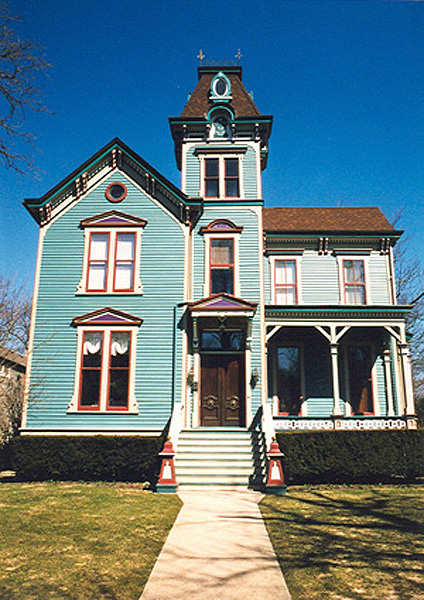 The victorian home is noticeably bright in color